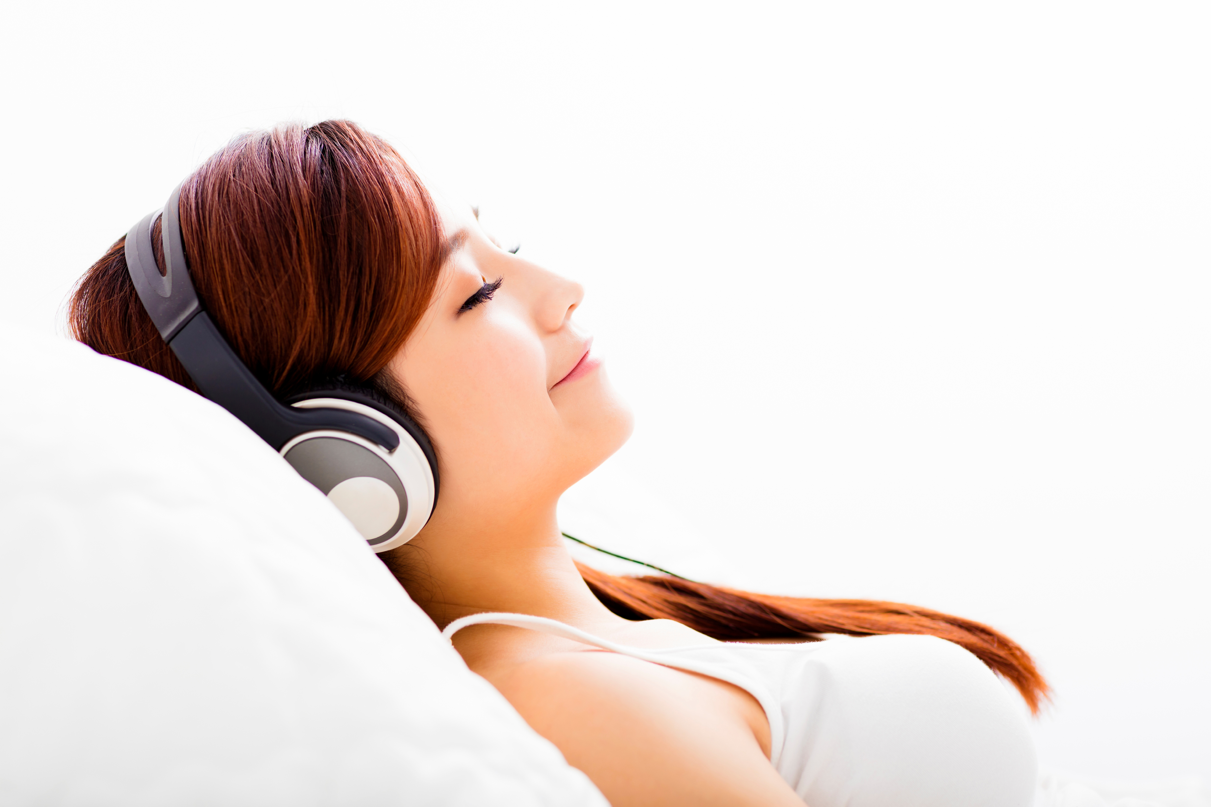 Relaxed young woman with headphones listening to music.